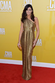Karen Fairchild shined in this rich gold gown on the CMA Awards red carpet.