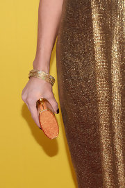 Karen Fairchild was in the mood for sparkle at the CMA Awards, wearing a glittery dress and accessorizing with gold bangles and a metallic clutch.
