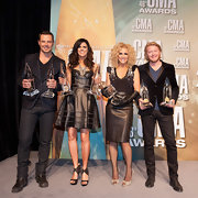Karen looked like a rocker in this leather corset dress after receiving her awards at the CMAs.