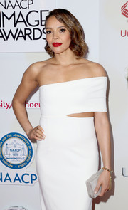 Carmen Ejogo paired a frosted white box clutch by Rauwolf with an asymmetrical dress by Solace London for a minimalist-modern look during the NAACP Image Awards.