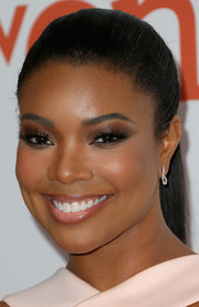 Gabrielle Union played up her eyes with a heavy application of brown shadow.