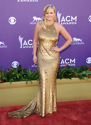 Miranda Lambert was dripping in gold at the Academy of Country Music Awards in this trained number.