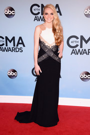 Danielle Bradberry went for modern elegance in a tricolor lace-panel evening dress by BCBG during the CMA Awards.