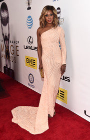 Laverne Cox looked regal at the NAACP Image Awards in a light-peach one-shoulder gown with a long train.