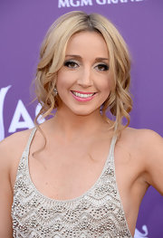 Ashley Monroe chose a romantic bobby pinned updo with cascading, face-framing curls.