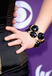 Sunny Sweeney chose a bold black and gold beaded bracelet to act as her statement piece at the ACMs.