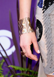 Kelleigh Bannen added a touch of contemporary flare to her look with this gold cuff.