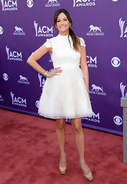 Kacey Musgraves dazzled on the ACM red carpet, where she wore this lace and feather frock.