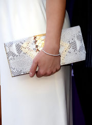 Kimberly Perry chose this metallic silver snakeskin clutch to add some shine to her red carpet look at the 2013 ACMs.