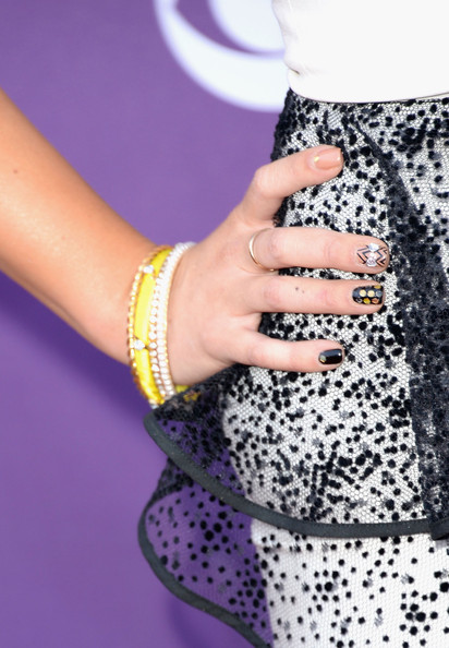 Can't decide on a look? Take a page from Meghan Linsey's book and pick a different design for each nail.