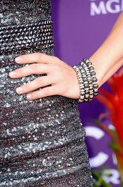 Cassadee Pope piled on four matching beaded bracelets in a cool gunmetal color at the 2013 ACMs.