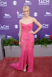Beth Behrs chose a strapless lace gown in a gorgeous pink hue for her feminine and elegant look at the 2013 ACM red carpet.
