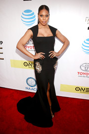 Laverne Cox oozed elegance wearing this embellished black fishtail gown by Marc Bouwer Couture at the NAACP Image Awards.