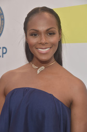 Tika Sumpter topped off her look with a simple half-up hairstyle when she attended the NAACP Image Awards.