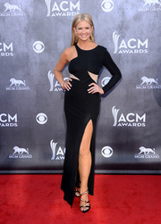 Nancy O'Dell went for a sexy, modern look in an asymmetrical black gown with a thigh-high slit during the ACM Awards.