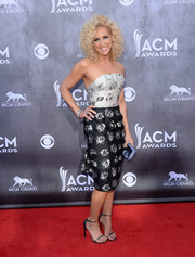 Kimberly Schlapman was sexy yet classy in a monochrome printed strapless dress during the ACM Awards.