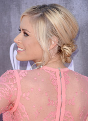 Sarah Davidson styled her hair into a romantic knotted chignon with wavy tendrils for the ACM Awards.