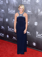 Gwen Sebastian chose a navy halter gown with an embellished neckline for the ACM Awards.