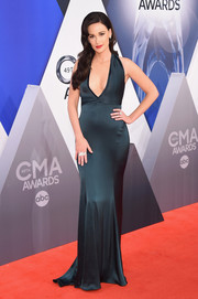 Kacey Musgraves brought some Old Hollywood glamour to the CMA Awards red carpet with this plunging teal halter gown by St. John.