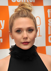Elizabeth Olsen's casual updo looked adorable at the screening of 'Martha Marcy May Marlene'. Styling her hair up and away from her face made her lovely features the focus.