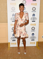 Samira Wiley went ultra feminine in a Zimmermann floral mini dress with a plunging neckline and a ruffle hem at the NAACP Image Awards nominees luncheon.
