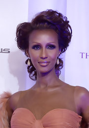Iman wore her hair in a gorgeous updo at the 4th Annual BET Honors. Her soft curls and flow-y apricot dress created an ultra romantic look.