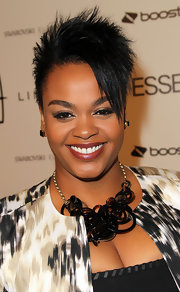Singer Jill Scott aired her abstract print jacket with a black statement necklace.