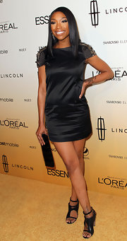 Brandy was back in black in a chic mini dress with embellished sleeves.