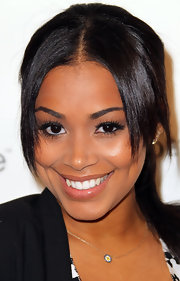 Lauren London boosted her natural look with fluttering false lashes.