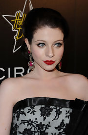 Michelle Trachtenberg stepped up her look with gold and pink gemstone earrings.
