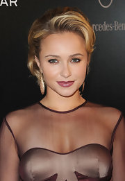 Hayden Panettiere perfectly matched her sheer dress with mauve lipstick in a matte texture. It was the perfect complement to her wine colored dress.