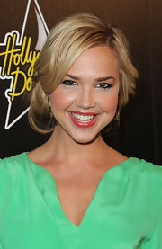 Arielle Kebbel pinned her blond locks back in a loose bun at the nape of her neck.