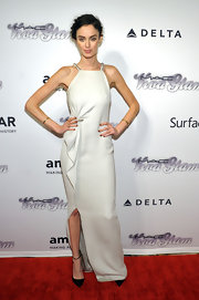 Nicole Trunfio stuck to a simple white gown with a side ruffle for the amfAR Inspiration Gala New York.