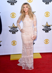 Kimberly Perry polished off her look with a nude hard-case clutch by Amanda Pearl.