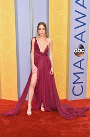 Danielle Bradbery got majorly sultry in a draped raspberry fishtail gown with a plunging neckline and a hip-high slit during the CMA Awards.