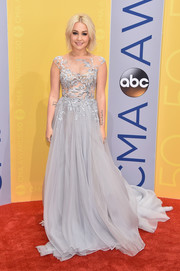 RaeLynn looked enchanting in a princess-worthy pale-gray gown, featuring a sheer, embroidered bodice and a floor-sweeping skirt, at the CMA Awards.