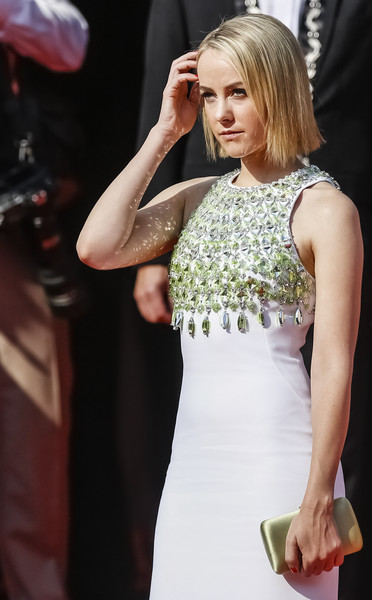 Jena Malone paired a lime-green satin clutch by Prada with a rhinestone-embellished dress for the 2015 Karlovy Vary International Film Festival opening ceremony.