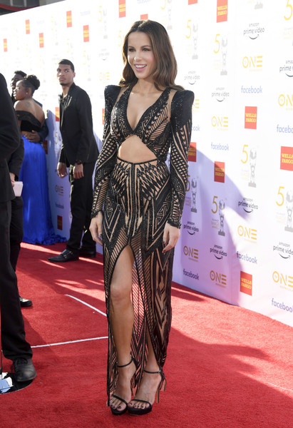 Kate Beckinsale sent temperatures rising with this sheer cutout gown by Julien Macdonald at the 2019 NAACP Image Awards.