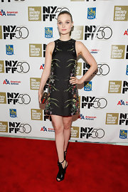 Bella Heathcote wore a refreshing black floral printed mini dress at the 50th New York Film Fest.
