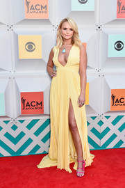 Miranda Lambert caught eyes with her hot-pink Joyce Echols gun-in-holster sandals.