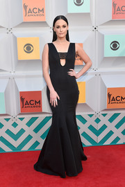 Kacey Musgraves cut a shapely figure in this black mermaid gown at the Academy of Country Music Awards.