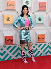 Katy Perry finished off her cool and colorful ensemble with pink and black cow-print boots, also by Jeremy Scott.