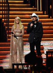 Carrie Underwood looked every bit the superstar in this fully embellished, caped catsuit by Elie Youssef at the 2017 CMA Awards.