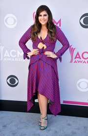 Hillary Scott played with colors, pairing her purple dress with iridescent strappy sandals by Kurt Geiger.