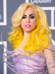 Miss Gaga wore a shocking yellow wig with her one of a kind Armani ensemble at the Grammy Awards. The side-parted hairstyle was waved and two-toned for a truley shocking look.