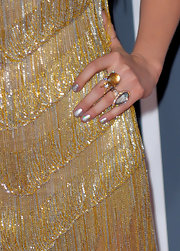 Never one to forget her bundles of jewelry, Kesha showed off her star style at the Grammy awards donning a few sparkling cocktail rings.