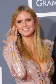 Heidi loves to have fun with her jewelery and she spiced up her sequin dress with a darling gold butterfly ring.