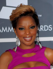 Mary J. Blige completed her sizzling hot pink dress with elaborate diamond tiered earrings.
