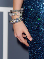 Country star Taylor swift added these bracelets to her blue sequined gown, which added tons of deminsion.