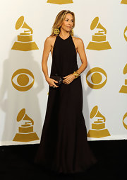 Cheryl dazzles at in a simple black silk-georgette floor-length gown at the Grammys.